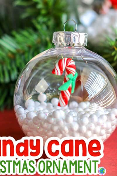 Easy DIY Christmas ornament craft for preschoolers! Clear Christmas ornament filled with fake snow and miniature candy canes for preschoolers to make in December.