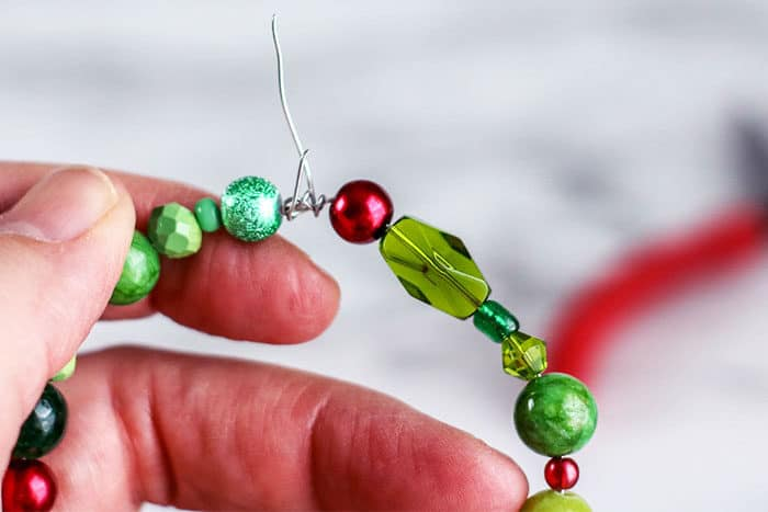 Tie both ends of the beaded wire Christmas wreath together to make a Christmas ornament for kids