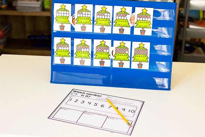 Free printable Christmas tree counting game for preschool math centers and small groups.