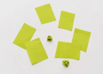 Overhead shot of construction paper squares and crumbled construction paper.
