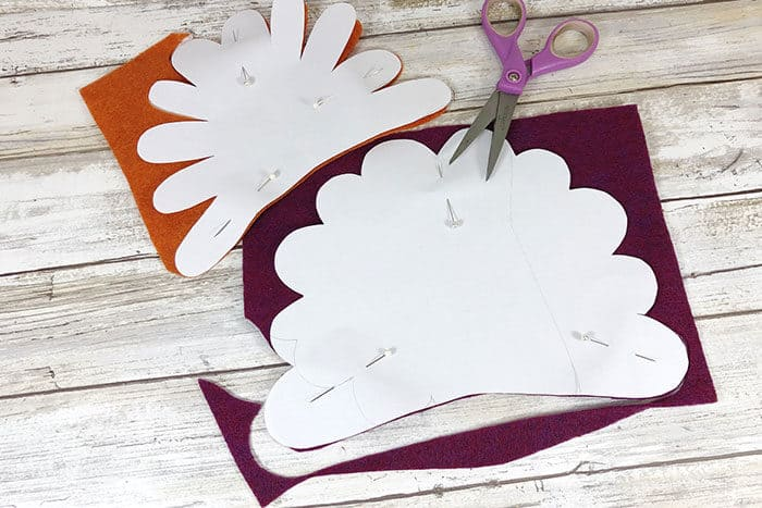 Cut turkey feathers for a felt turkey craft out of fall colored felt for a simple Thanksgiving craft for kids.