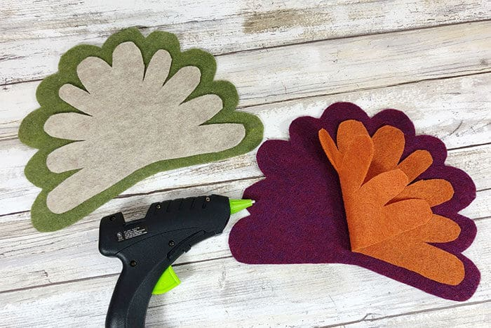 Layer pieces of felt to create turkey feathers for this simple Thanksgiving craft for kids.