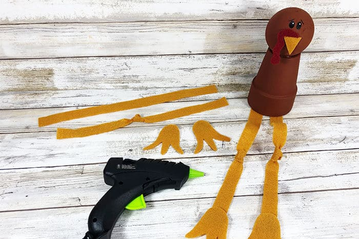 Cut out the turkey legs from pieces of yellow felt for an Easy Thanksgiving activity for kids