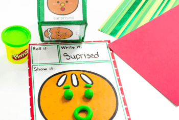 Use play dough to create the emotion shown on the differentitated instruction cube dice with emotion inserts in this free printable Preschool Emotions game with a fun Gingerbread theme.