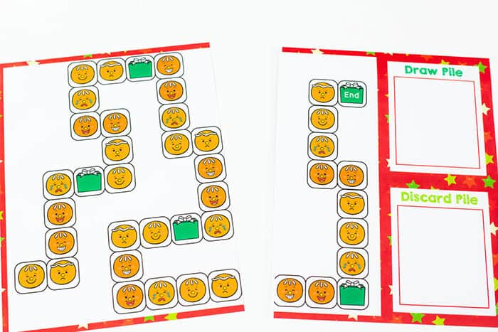 Tape two pieces of paper together to make a game board for this engaging gingerbread theme emotions board game for preschoolers.