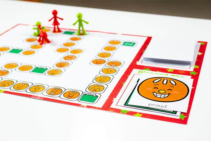 Gingerbread emotions board game for preschoolers. Learn about emotions through a free printable gingerbread themed game.