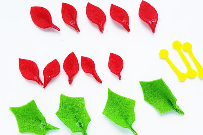 Create a Christmas flower with felt for a natural Christmas wreath craft for kids during your Christmas theme