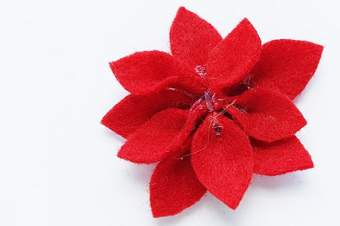 Make a poinsetta from red felt to put on your preschool Christmas craft