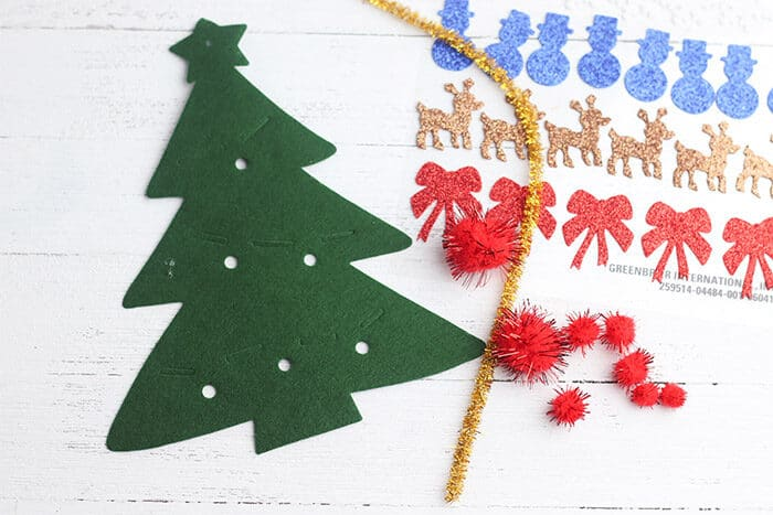 Grab a felt Christmas tree, pom poms, pipe cleaners and Christmas stickers for this fun Christmas decorating craft for kids.