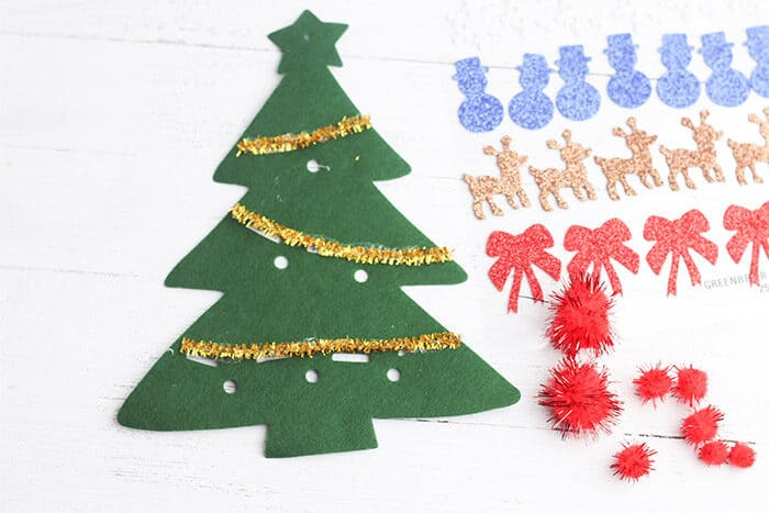 Felt Christmas trees are a great way to decorate Christmas trees with preschoolers without giving them access to all the breakable ornaments. Use pipe cleaners to add tinsel to the felt Christmas tree