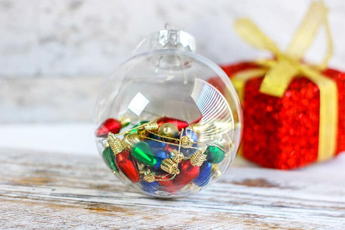 Fast and easy Christmas lights homemade Christmas ornament for preschoolers to work on fine motor skills during your Christmas theme