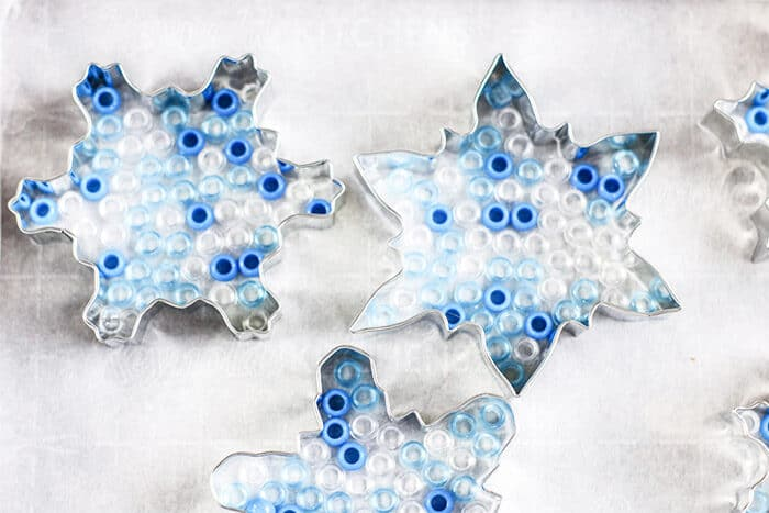 Use a snowflake cookie cutter to make ornaments for the Christmas tree or use them as a suncatcher