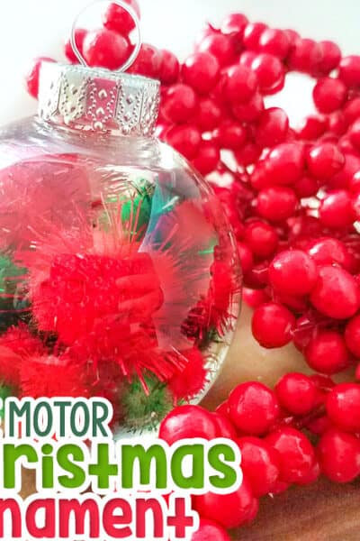 Create a DIY Christmas ornament with red and green pom poms Fine motor Christmas ornament for kids