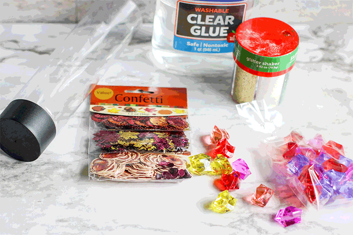 Use glitter, fall confetti and a water bottle to create a Thanksgiving sensory bottle for kids
