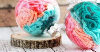 Use yarn scraps in your favorite colors and a clear, plastic Christmas ornament to create this simple yarn Christmas ornament craft for preschool.