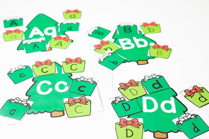 Sort uppercase and lowercase presents onto the matching Alphabet Christmas trees in this free printable Christmas Tree Alphabet Sorting Activity for Preschoolers