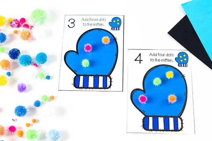 Free printable mitten counting cards for your winter preschool math centers. Use play dough, pom poms, magnetic counting circles to create 'dots' on the mittens.