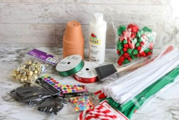 The supplies for the Terracotta Pot Snowman Ornament.