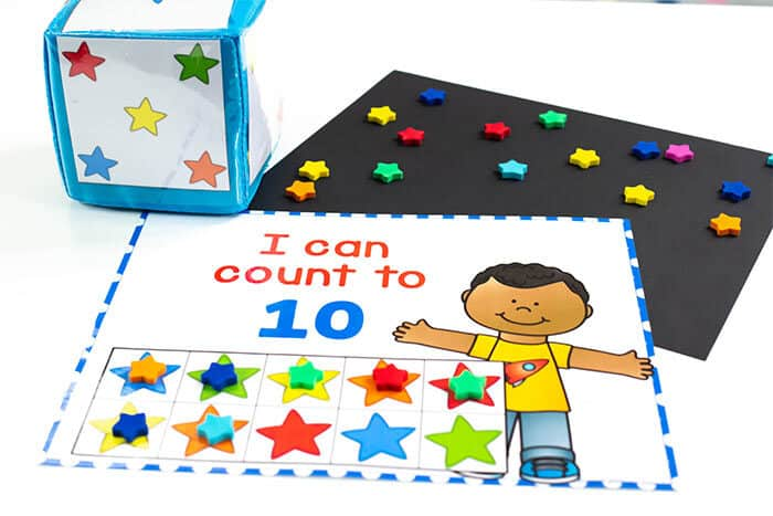 Use mini erasers from the Target Bullseye Playground to count to 10, 20 and 100 in English and Spanish.