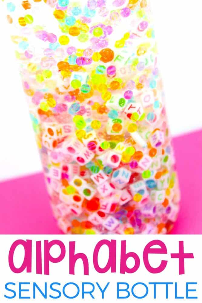DIY Rainbow Alphabet Sensory Bottle with a pink background.
