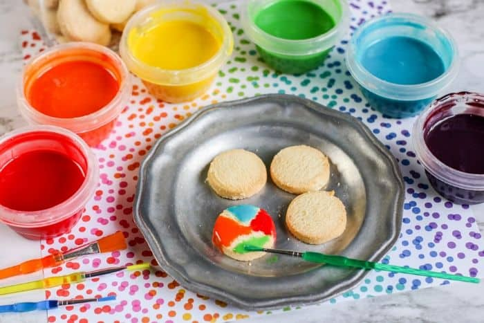 Painting cookies with edible paint for kids.