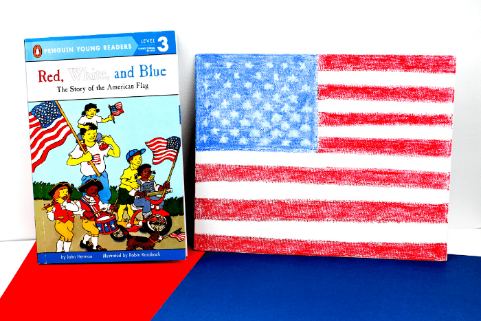 American Flag Canvas art with a book about the story of the American flag.