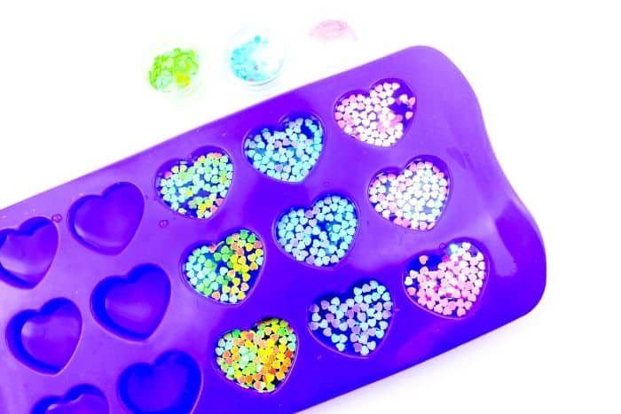 Glutter and water in a purple silicone heart mold.