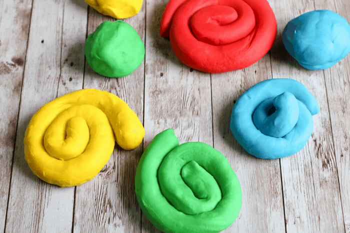 The best easy homemade play dough recipe for kids! Make rainbow play dough in just a few minutes that your kids will LOVE! #