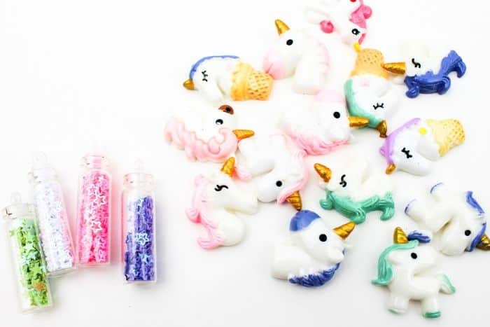 Unicorn Ice Cube Painting supplies. Mini star glitter and mini unicorns on a white background.