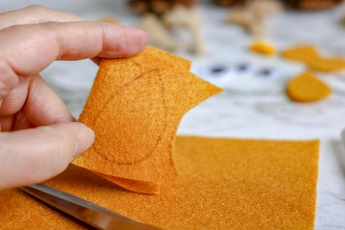 Tracing the wing shape for making an owl craft for kids.