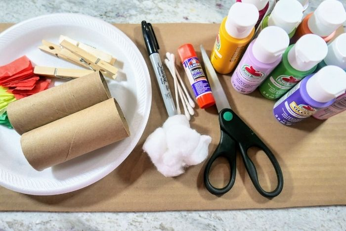 Supplies needed to make seasons of a tree craft for kids.