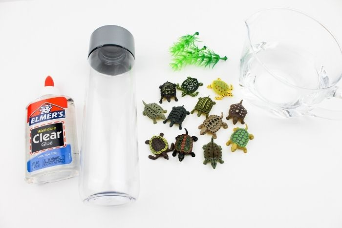 Supplies needed for making a turtle sensory bottle.