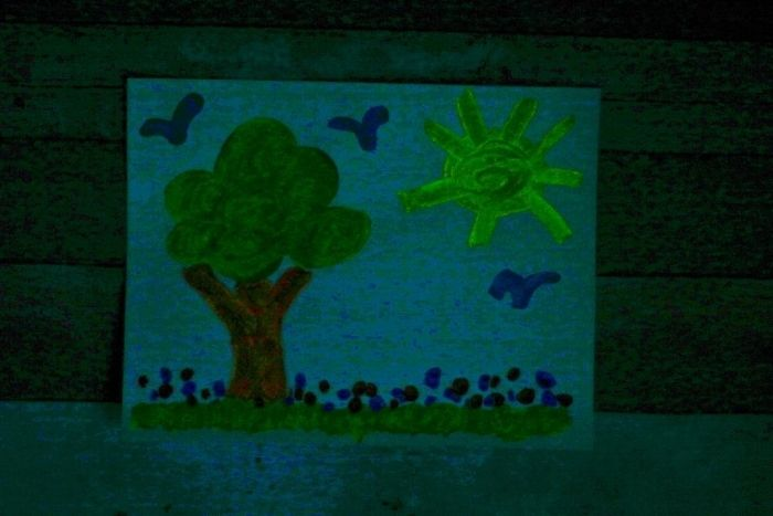 Glow in the dark paint landscape picture.