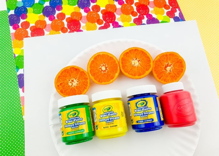 Supplies for doing an orange painting activity.