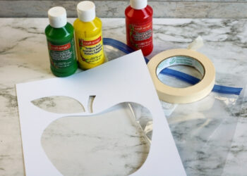 Picture of the supplies for the Apple Theme Mess Free Finger Painting in a Bag.