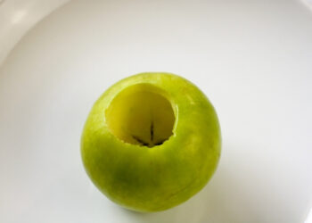 Overhead shot of an apple that has been hollowed out for the volcano science experiment.