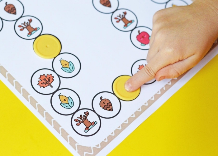 Moving pieces on a fall game for preschoolers.