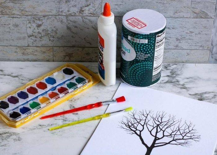 Supplies needed for making a fall tree salt painting.