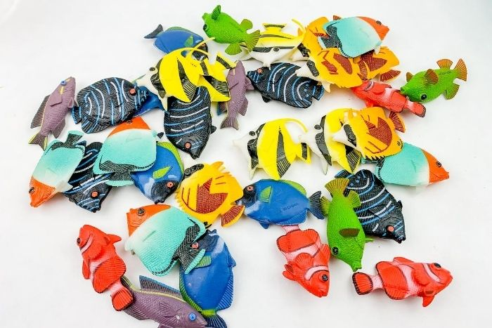 Overhead shot of plastic toy fish.
