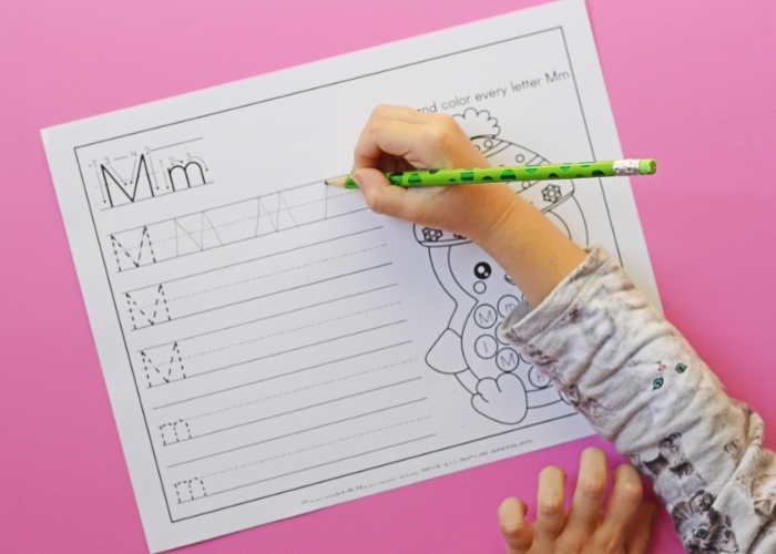 Overhead picture of a child completing a letter