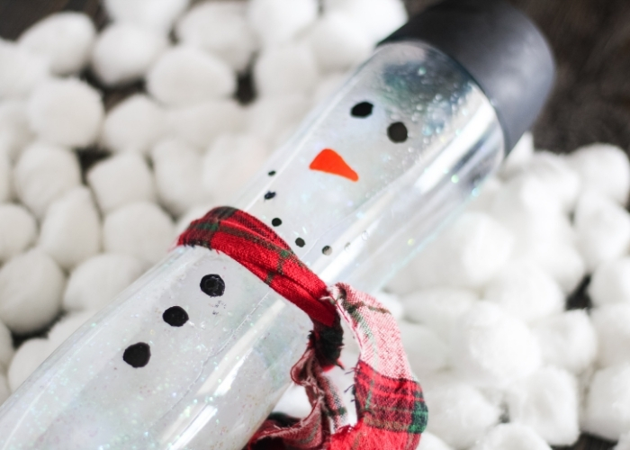 Overhead view of the finished snowman sensory bottle.