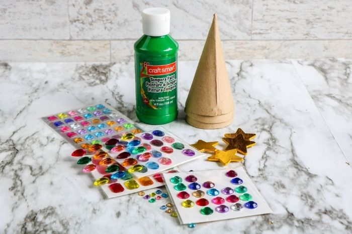 Supplies for making a christmas tree craft for kids.