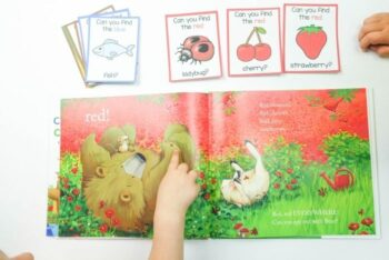 A kids completing a reading color activity with printable