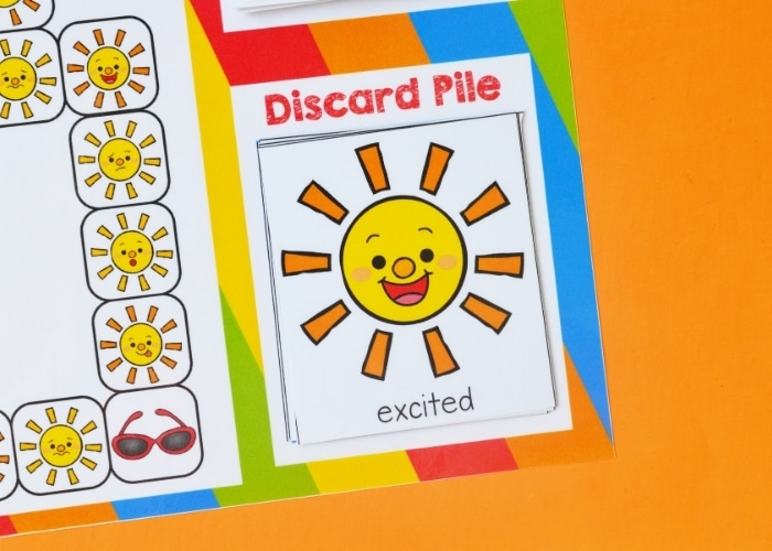 Close up of a sun themed emotions game card for the emotion