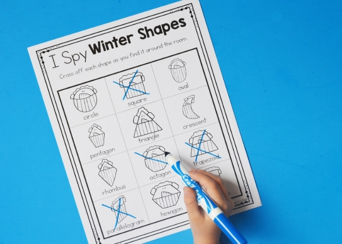 "A child completing the ""I Spy Winter Shapes"" activity."