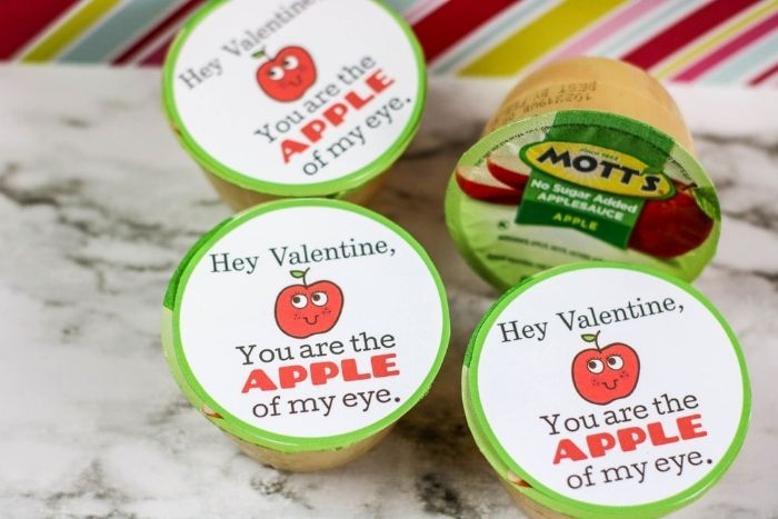 "Apple sauce containers with a free printable on them that says, ""Hey valentine, You are the APPLE of my eye."""