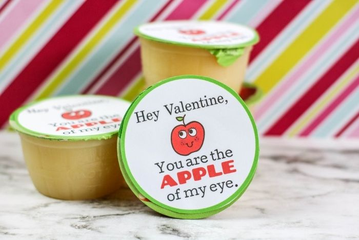 The Free Applesauce Valentine Printable for Kids on apple sauce containers.