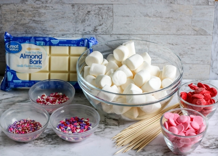 Ingredients for making Valentine marshmallow pops.