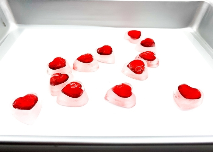 Finished heart ice cubes in a tray for the preschool valentine's day sensory play with ice.