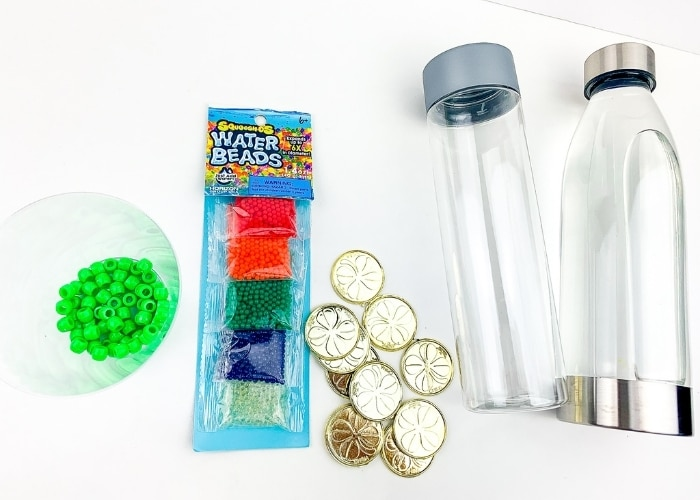 The supplies for the St. Patrick's Day homemade sensory bottles.